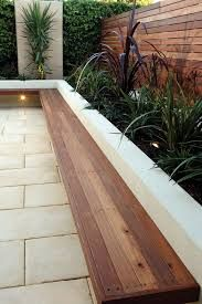 concrete seat wall against wooden fence - Google Search