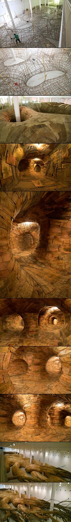 Art & Installation - Brazilian artist Henrique Oliveira's incredible installation titled Transarquitetônica invites you to go on a fantastical journey through a cavernous interior. The recently-completed work is his largest to date, and he has successfully created a fully-immersive environment inside of a large, root-like system.