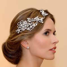 Our Fleur Vine Headpiece featues a romantic design with a hint of 1940s glamour. Shop at Glitzy Secrets for beautiful wedding hair accessories.