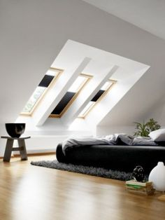 When creating a loft conversion and a loft bedroom in particular, think about the light, space and how it will make you feel. Attic rooms are tricky to design so ensure you have enough roof windows and enough loft conversion storage! Skylight Bedroom, Skylight Blinds, Bedroom Loft, Master Bedroom, White Bedroom, Attic Renovation, Attic Remodel, Attic Rooms, Attic Spaces
