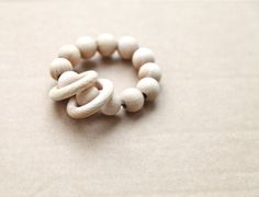 Teething ring toy with wooden beads w/ 2 wooden rings