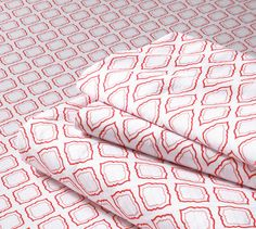 These would look amazing in a pink and orange combo: 300-count Geo Print Sheet Set or Pillowcase from Lands' End