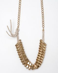 Nuts And Leather Necklace. Could probably be DIY'ed, but it's only $38 #necklace #jewelry