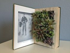 Upcycled Vintage Book Planter for Succulents or Flowers. $30.00, via Etsy. I'm going to try to make one myself!