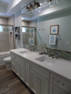 Caesarstone fresh concrete vanity top from Pacific Shore Stones Arroyo Grande. Bath design by Cindy Dakovich of Impact Interiors.