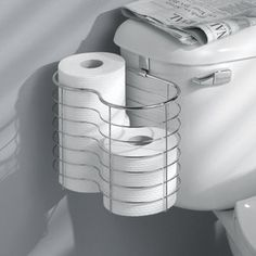Hang a medium Shower Caddy (from WalMart) onto the toilet to keep extra toilet paper handy - I love this idea-this is great for keeping the DOG from the toilet paper on the shelf!!!