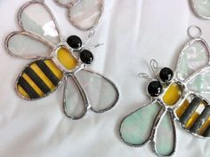 Here are some lovely sun catchers in the shape of a bee made out of beautiful stained glass. Each piece of glass has been cut, ground, foiled and then soldered together. The glass used is yellow water glass, clear irridised granite back glass, black g. Stained Glass Designs, Stained Glass Panels, Stained Glass Projects, Stained Glass Patterns, Leaded Glass, Stained Glass Art, Mosaic Glass, Fused Glass, Art Nouveau
