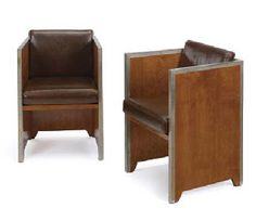 PAUL T. FRANKL (1887-1958)  A PAIR OF WALNUT AND NICKELED-METAL ARMCHAIRS, CIRCA 1930