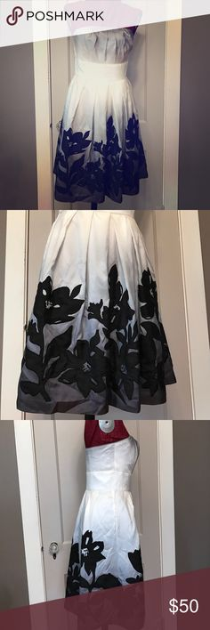 Strapless White House Black Market party dress Stunning strapless dress from White House Black Market.  Size 4 and only worn once. Very neat gray/ white ombré effect with black flower pattern stitched on. Hits right above the knees White House Black Market Dresses Strapless