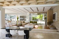 ceiling in living room. Interesting idea for functional zoning