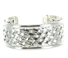 We love this woven silver cuff!  http://www.majestical.com/Wide-Woven-Silver-Cuff-p/159-grs-jm.htm