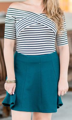 Striped off-the-shoulder top + hunter green skater skirt + distressed gold bracelets . Click through this pin to see this cute fall outfit idea + learn where to buy each item. #Zapposstyle #MyLuckyBrand sponsored by @zappos  @luckybrandjeans