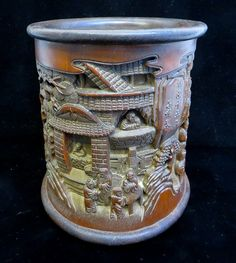 "Bamboo brush pot with carved figures and calligraphy. 6 3/4"" x 6 1/4"""