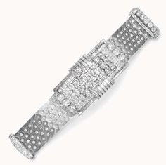 """A RETRO """"LUDO HEXAGONE"""" DIAMOND AND PLATINUM BRACELET, BY VAN CLEEF & ARPELS The flexible wide band designed as honeycomb-shaped platinum links, each with a star-set diamond, centering upon a geometric openwork rectangular plaque with three rows of circular-cut diamonds, flanked by a series of baguette-cut diamonds, within a pavé-set, circular and baguette-cut diamond two-tiered frame, mounted in platinum, circa 1940, Signed Van Cleef & Arpels, Paris"""