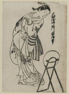 Nishikawa Sukenobu - Title: Girl looking over shoulder into mirror. From the album (Yamato Furyu) Nishikawa Yasa Sugata illus. 11