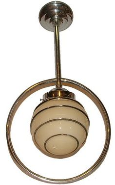 These two American art deco ceiling lamps resembling flying saucers