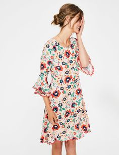 This is not one of those dresses that you'll wear once and never again. This extra-special number is expertly crafted from supersoft satin-backed crepe, with a flattering empire waist that flares out to gently skim the body. With its standout tropical print, double-frilled sleeves and beautiful drape, you'll be pulling this one out of your wardrobe for seasons to come.
