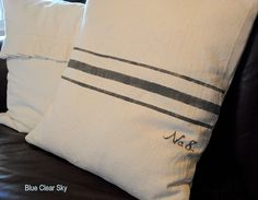Faux vintage grain sack pillows using drop cloth material and grey paint.