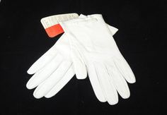 Vintage 1950's Christian Dior Kid Leather Gloves, £52 by All That Glitters Vintage -  Beautiful Christian Dior Original 1950/60's Kid Leather Gloves with original store tags.  Top quality kid leather gloves by the French fashion designer – one of the world's top fashion houses.  Unworn condition with store tags.   Colour:- Winter White  Size:- 6 ¾ inches  Length:- 8 ½ inches   Circa 1950 - 1960's