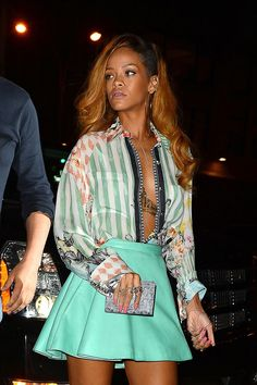 Singer Rihanna stepped out in this high-waisted mint skirt and button-up top, but forgot one important part -- actually buttoning up! This is a serious wardrobe malfunction waiting to happen.