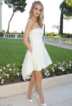 Pure and simple: Rosie looked effortlessly chic in her feminine and flirty strapless white gown
