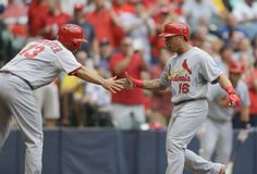 Kolten Wong reacts with Matt Carpenter after Wong's two-run home run against the Brewers... second inning. 7-12-14