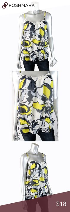 """Banana Republic Floral Ruched Ruffle Top J015 Banana Republic floral tank top with ruffled gathered bottom hem and neckline and allover blue, white and yellow flowers. Fully lined. This top would look cute under a blazer for work or with shorts in the summer!  • 100 polyester • 21"""" armpit to armpit • 26"""" length • Excellent condition, no flaws or signs of wear.  All pictures are my own & of the acutal item for sale. Offers welcome, no trades. Banana Republic Tops Blouses"""