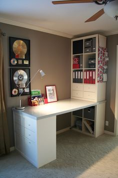 "Love this custom desk space- ""This is my desk project.  It was put together with Expedit bookshelves from IKEA, a solid core door (which I painted and polyeurythaned), and storage inserts also from IKEA.  I think it turned out rather nicely if I do say so myself!"""