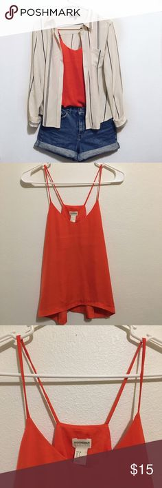 H&M Bright Orange Tank Top Conscious Collection Bright fun orange tank top in excellent condition, perfect for a nice sunny day with a pair of shorts or even jeans! This splash of hot color is an essential for any closet. ⭐️ Please feel free to ask any questions or make an offer H&M Tops Tank Tops