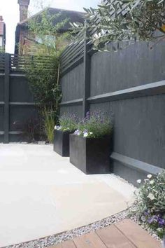 Fence painted in Farrow and Ball Downpipe. Works beautifully as a backdrop to greenery and lavender
