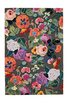 This bright floral rug has us dreaming of an entire living room redesign.