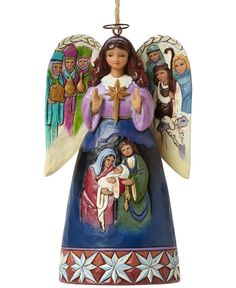 This Nativity Angel ornament from Jim Shore is a heartfelt depiction of the timeless Christmas story. The Holy Family forms the central image; beautifully rendered in colorful detail. Folk-art inspire