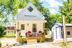 This tiny home features 398 square feet of space and includes a bedroom and bathroom, combined kitchen/living room/dining room space and a loft.
