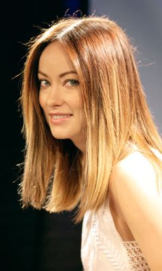 When you look at the long bob (aka lob) from the front, like Olivia Wilde's, the two straight side panels of hair that hang down right beside each cheekbone, slightly mask the width of the cheekbones, forehead, and jawline that widen a square face. These factors combined is why this style is spot-on for an angular shape.