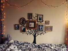 Family tree: great way to display pictures and decorate with painted trees!