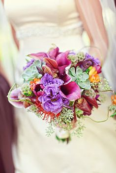 ...loved all of these fall textures–everything from scabiosa pods, pin cushion protea, succulents,curly willow just to name a few– the colors were shades of purples, accented with greens and a pop of orange.