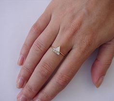Triangle ring with line of diamonds
