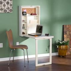 A winter white finish and fold away, space saving storage highlight this desk. The desk also features adjustable shelves and corkboard organizer. Harper Blvd furniture brings homes together with curat