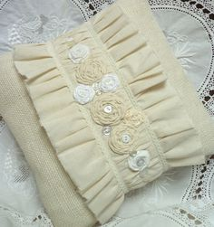 "12"" square-OFF WHITE Burlap and Muslin Pillow Cover. Sweet simplicity.  Shabby Chic Ruffles, Rosettes, Buttons, Lace and Beads.. $32.00, via Etsy."