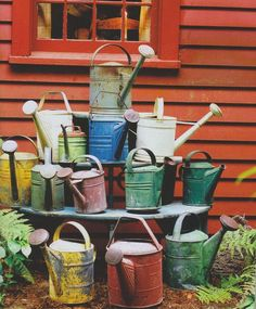 "Collection of ""vintage watering cans""."