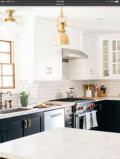 Fresh Black Cabinets with Gold Hardware