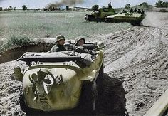 """Volkswagen (Porsche) Type 166 """"Schwimmwagen"""" with Panzer V """"Panther"""" & mittlere SPW Sd Kfz 251 in the background; 5.SS-Panzer-Division """"Wiking"""" Poland 1944..."""