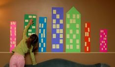 Easy City Scape Mural - construction paper buildings and post-it note windows