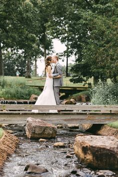 Bride and Groom portraits at the waterfall.  Swoooon! #memphisweddings #nature #romantic #springcreekranchweddings #kellyginnphotography