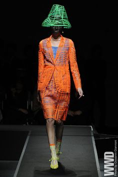 """Anrealage RTW Spring 2013  Designer Kunihiko Morinaga opened his show by sending out his girls in glow-in-the-dark cage-like dresses, recalling the film """"Tron."""""""