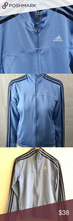 Adidas Classic Women's Track Jacket Size Medium Adidas Classic Women's Track Jacket Size Medium - Preloved in great condition. Classic Adidas track jacket in light blue with 3 stripes in dark blue on the sleeve and shoulder. There are reflective Adidas logos on the chest and on the backside below the neck. This jacket is full zip and has double zipper closure from the hem and the neck. There are two front pockets that have zip closure. Minor pull in the fabric can be seen in the last photo…