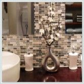 Matching flowers to your tiles creates a stunning effect. See more bathroom tiles at glasstilestore.com