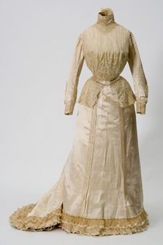 1901 Ivory satin wedding gown worn by Olive Freeman Brown. Made by dressmaker Hattrix J. English, St. Paul, Minnesota.