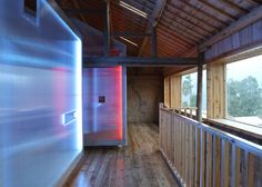 He Wei adds portable plastic rooms to youth hostel in a converted Chinese house