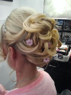 Gorgeous whimsical updo. Perfect for a spring or summer wedding. Hair and Makeup done in store by Maria Josette